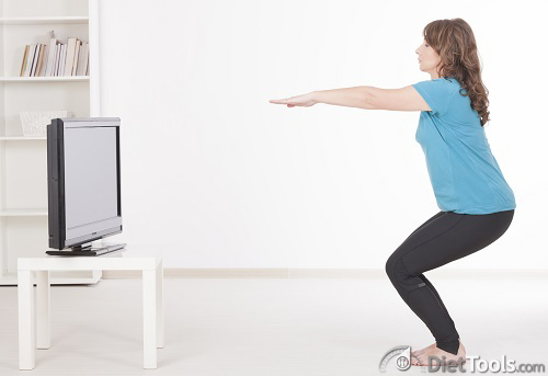 Woman exercisng at home