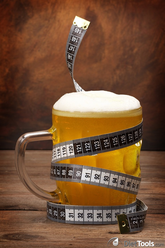 Beer mug and tape measure . Diet concept